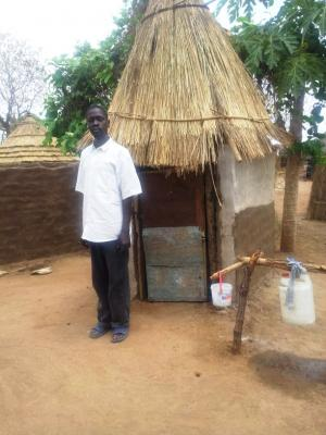 Man with CLTS latrine in South Sudan