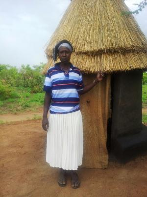 woman with her latrine, South Sudan