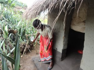 Woman with her CLTS latrine and handwashing station in Malawi