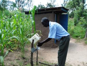 A man shows his handwashing station in Nambale