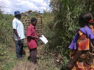 Village Health Team doing CLTS follow up in Kigwangu Village