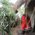 Woman in Malawi with her latrine and handwashing station